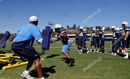 Antwan Barnes San Diego Chargers linebacker Antwan Barnes charges off hitting the blocking sled during practice at the Chargers' training camp in San Diego