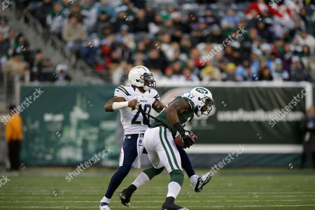 Antoine Cason, Braylon Edwards San Diego Chargers cornerback Antoine Cason tugs on the equipment of New York Jets wide receiver Braylon Edwards (17) during the second half of an NFL football game, in East Rutherford, N.J