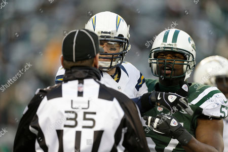 Phililp Rivers, Bart Scott, Joh Hussey San Diego Chargers quarterback Philip Rivers (17) and New York Jets inside linebacker Bart Scott (57) argues with line judge John Hussey (35) during the second half of an NFL football game, in East Rutherford, N.J. The Chargers defeated the Jets 27-17