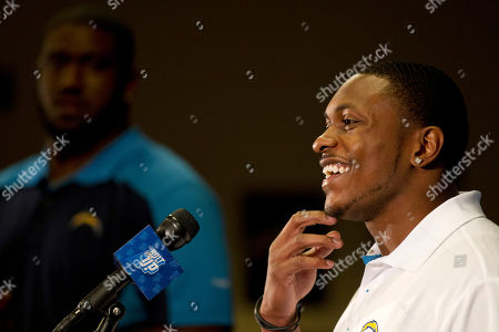 Stock Photo of Eddie Royal, Jared Gaither Wide receiver/punt returner Eddie Royal, right, smiles during a news conference introducing him as a San Diego Chargers football player, in San Diego. Royal, who previously played for the Denver Broncos, agreed to a three-year contract with the Chargers. Chargers left tackle Jared Gaither, left, looks on