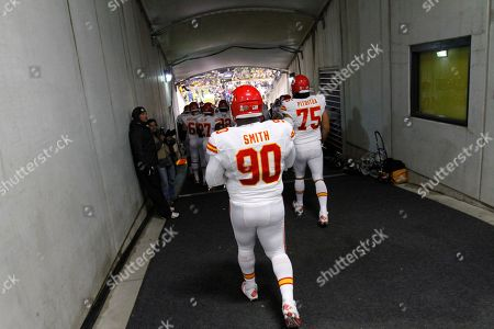Shaun Smith, Ropati Pitoitua Kansas City Chiefs defensive tackle Shaun Smith (90) and Kansas City Chiefs defensive end Ropati Pitoitua (75) walk to the field before an NFL football game against the Pittsburgh Steelers in Pittsburgh, . The Steelers won 16-13 in overtime