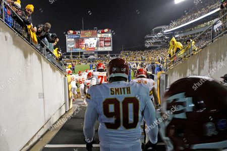 Shaun Smith Kansas City Chiefs defensive tackle Shaun Smith (90) walks to the field before an NFL football game against the Pittsburgh Steelers in Pittsburgh, . The Steelers won 16-13 in overtime