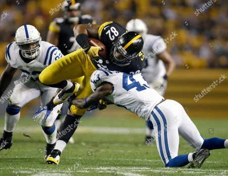 Weslye Saunders, DJ Johnson Pittsburgh Steelers tight end Weslye Saunders (82) is tackled by Indianapolis Colts defensive back DJ Johnson (43) in the second half of the NFL preseason football game in Pittsburgh
