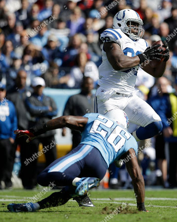 Dwayne Allen Indianapolis Colts tight end Dwayne Allen (83) makes the catch as Tennessee Titans strong safety Jordan Babineaux (26) falls during the first half of an NFL football game, in Nashville, Tenn