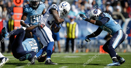 Vick Ballard,Jordan Babineaux,Michael Griffin Indianapolis Colts running back Vick Ballard (33) runs as Tennessee Titans strong safety Jordan Babineaux (26) tackles and Tennessee Titans free safety Michael Griffin (33) defends during the first half of an NFL football game, in Nashville, Tenn