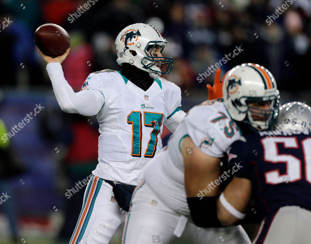 Nate Garner, Ryan Tannehill Miami Dolphins quarterback Ryan Tannehill (17) passes against the New England Patriots behind tghe block of Dolphins tackle Nate Garner (75) during the first quarter of an NFL football game in Foxborough, Mass