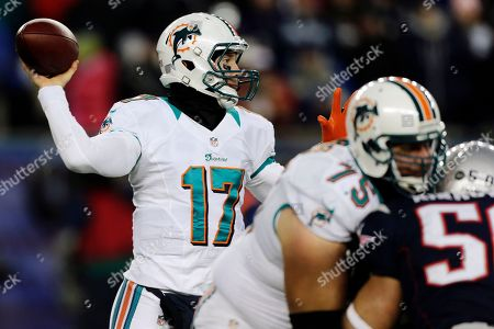 Nate Garner, Ryan Tannehill Miami Dolphins quarterback Ryan Tannehill (17) passes against the New England Patriots behind the block of Dolphins tackle Nate Garner (75) during the first quarter of an NFL football game in Foxborough, Mass