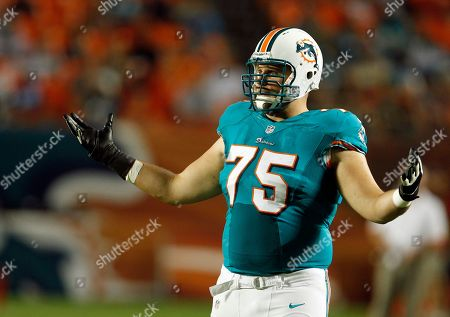 Nate Garner Miami Dolphins offensive tackle Nate Garner (75) gestures during the second half of an NFL preseason football game against the Atlanta Falcons, in Miami