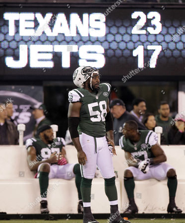 New York Jets' Bryan Thomas (58) and teammates Bart Scott (57) and Calvin Pace (97) watch from the sidelines late in the second half of their 23-17 loss to the Houston Texans in an NFL football game in East Rutherford, N.J. Some of the Jets' biggest flaws were on full display in their loss to the Texans. They couldn't run, the defense couldn't stop the run and Tebow still isn't getting on the field much