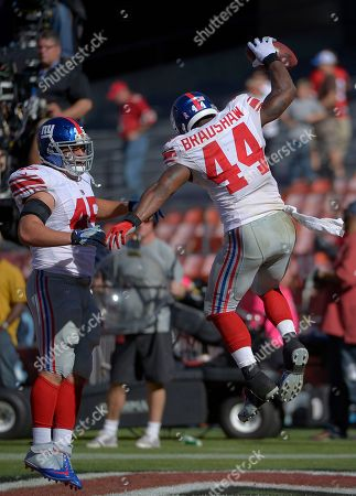 Ahmad Bradshaw New York Giants running back Ahmad Bradshaw (44) celebrates with fullback Henry Hynoski (45) after scoring a touchdown against the San Francisco 49ers during the third quarter of an NFL football game in San Francisco