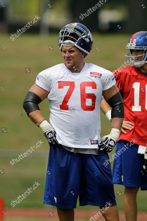 Chris Snee, Eli Manning New York Giants guard Chris Snee (76) and Eli Manning wait out a break in practice at the New York Giants NFL football training camp in Albany, N.Y