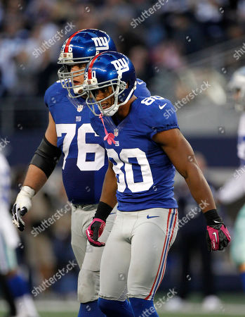 Victor Cruz, Chris Snee New York Giants' Chris Snee (76) helps Victor Cruz (80) off the field after Cruz was involved in a play where Dallas Cowboys' Danny McCray (40) intercepted a pass intended for Cruz during an NFL football game, in Arlington, Texas. The Giants defeated the Cowboys 29-24