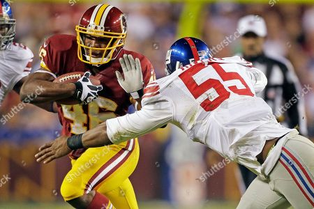 Alfred Morris, Keith Rivers New York Giants outside linebacker Keith Rivers (55) closes in on Washington Redskins running back Alfred Morris during the first half of an NFL football game in Landover, Md