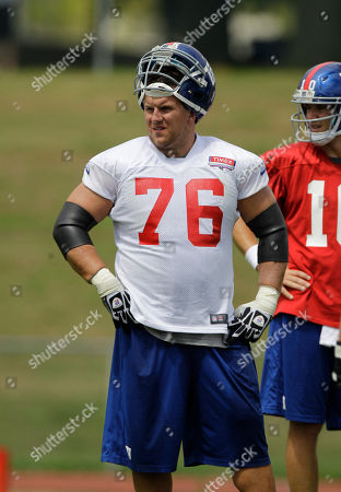 Chris Snee, Eli Manning New York Giants guard Chris Snee (76) and Eli Manning wait out a break in practice at the New York Giants NFL football training camp in Albany, N.Y. Snee, the 32-year-old son-in-law of coach Tom Coughlin, is retiring from the Giants because of a series of injuries. Snee met with the team, then decided to end his NFL career after 10 seasons