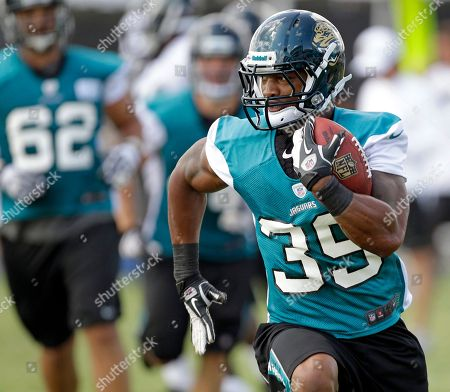 Richard Murphy Jacksonville Jaguars running back Richard Murphy (39) runs with the ball during a practice at NFL football training camp, in Jacksonville, Fla