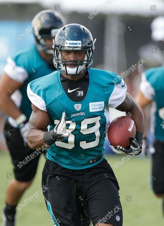Richard Murphy Jacksonville Jaguars running back Richard Murphy runs with the ball during a practice at NFL football training camp, in Jacksonville, Fla