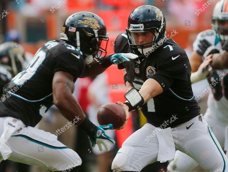 Chad Henne, Richard Murphy Jacksonville Jaguars quarterback Chad Henne (7) hands the ball to running back Richard Murphy (39) during the first half of an NFL football game against the Miami Dolphins, in Miami