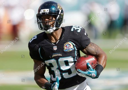 Richard Murphy Jacksonville Jaguars running back Richard Murphy (39) runs with the ball during the first half of an NFL football game against the Miami Dolphins, in Miami
