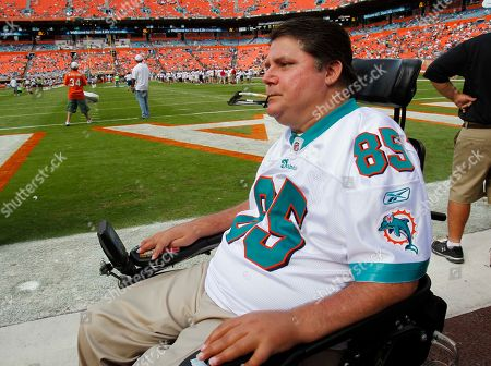 Marc Buoniconti Marc Buoniconti, son of former Miami Dolphins player Nick Buoniconti, observes the half time show where his father and all the members of the 1972 team are honored at an NFL football game against the Jacksonville Jaguars, in Miami