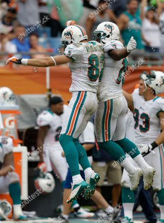 Brian Hartline, Nate Garner Miami Dolphins wide receiver Brian Hartline (82) celebrates a first down completion with tackle Nate Garner (75) during overtime of an NFL football game against the New York Jets in Miami, . The Jets defeated the Dolphins 23-20 in overtime