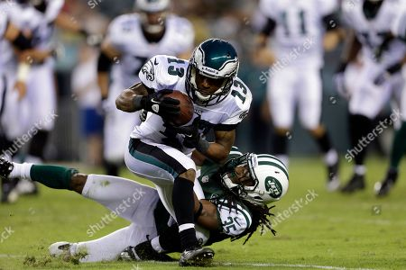 Damaris Johnson, Isaiah Trufant Philadelphia Eagles wide receiver Damaris Johnson, top, is tackled by New York Jets defensive back Isaiah Trufant in the first half of a preseason NFL football game, in Philadelphia