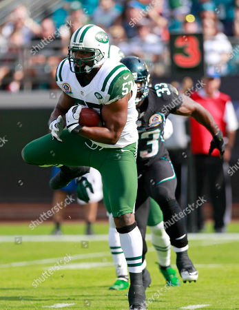 Bart Scott, Greg B. Jones New York Jets inside linebacker Bart Scott, left, intercepts a pass in front of Jacksonville Jaguars fullback Greg B. Jones (33) during the first half of an NFL football game, in Jacksonville, Fla