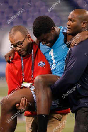 Emmanuel Acho Texas linebacker Emmanuel Acho is carried off the field after injuring himself during the 40-yard dash at the NFL football scouting combine in Indianapolis on