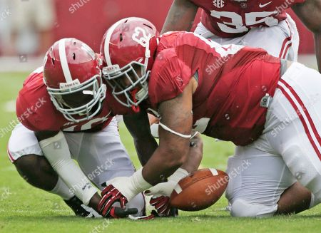 Alabama defensive lineman Brandon Ivory (62) battles with teammate John Fulton (10) for a Western Kentucky fumble in the first half of an NCAA college football game at Bryant Denny Stadium in Tuscaloosa, Ala. Alabama coaches had one statistic they could really gripe about with last season's defense: It forced few turnovers, and only three fumbles. The coaches visited NFL and college teams with that knack during the offseason and the top-ranked Crimson Tide has already induced seven turnovers in two games headed into Saturday's game at Arkansas