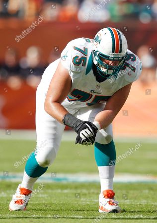 Nate Garner Miami Dolphins tackle Nate Garner waits for the snap during the first half of an NFL football game against the New England Patriots, in Miami