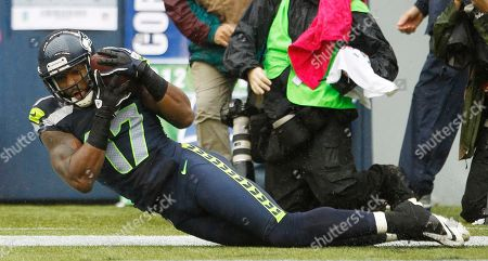Braylon Edwards Seattle Seahawks' Braylon Edwards catches the ball for a touchdown against the New England Patriots in the second half of an NFL football game, in Seattle