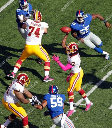 Robert Griffin III Washington Redskins quarterback Robert Griffin III (10) passes away from New York Giants outside linebacker Michael Boley (59) and Keith Rivers (55) during the first half of an NFL football game in East Rutherford, N.J