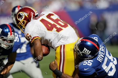 Keith Rivers New York Giants outside linebacker Keith Rivers (55) tackles Washington Redskins running back Alfred Morris (46) during the first half of an NFL football game in East Rutherford, N.J
