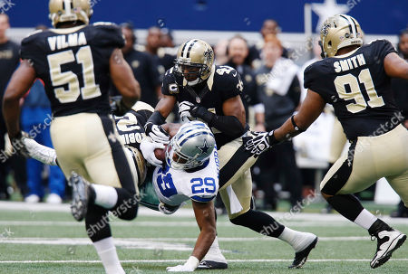 Jonathan Vilma, Patrick Robinson, DeMarco Murray, Roman Harper, Will Smith Dallas Cowboys running back DeMarco Murray (29) is taken down by New Orleans Saints cornerback Patrick Robinson (21) and strong safety Roman Harper (41) as Saints' Will Smith (91) and Jonathan Vilma (51) move in during the second half of an NFL football game, in Arlington, Texas