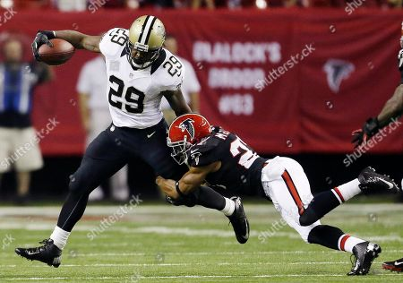 Chris Ivory, William Moore New Orleans Saints running back Chris Ivory (29) is stopped by Atlanta strong safety William Moore (25) during the first half of an NFL football game, in Atlanta