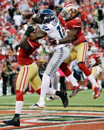 Patrick Willis, Dashon Goldson, Braylon Edwards San Francisco 49ers linebacker Patrick Willis (52) and safety Dashon Goldson (38) break up a pass intended for Seattle Seahawks wide receiver Braylon Edwards (17) during the second quarter of an NFL football game in San Francisco