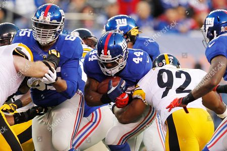 Ahmad Bradshaw, Will Beatty New York Giants tackle Will Beatty (65) blocks for Ahmad Bradshaw (44) as Pittsburgh Steelers outside linebacker James Harrison (92) makes the tackle during the first half of an NFL football game in East Rutherford, N.J