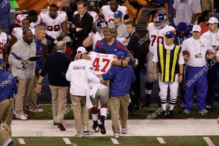Travis Beckum New York Giants tight end Travis Beckum (47) is helped off the field by staff during the first half of the NFL Super Bowl XLVI football game against the New England Patriots, in Indianapolis