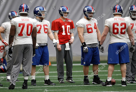 Eli Manning, Tony Ugoh, Chris Snee, David Baas, Mitch Petrus New York Giants' Eli Manning (10) stands with offensive linemen Tony Ugoh (70), Chris Snee (76), David Baas (64) and Mitch Petrus (62) during practice, in Indianapolis. The Giants will face the New England Patriots in the NFL football Super Bowl XLVI on Feb. 5