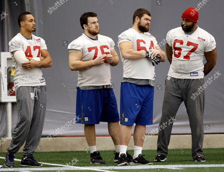 Travis Beckum, Chris Snee, David Baas, Kareem McKenzie New York Giants players, from left, Travis Beckum, Chris Snee, David Baas, and Kareem McKenzie watch during practice, in Indianapolis. The Giants will face the New England Patriots in the NFL football Super Bowl XLVI on Feb. 5
