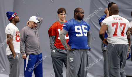 Hakeem Nicks, Mike Sullivan, Eli Manning, Rocky Bernard, Kevin Boothe New York Giants players, from left, Hakeem Nicks, coach Mike Sullivan, Eli Manning, Rocky Bernard and Kevin Boothe watch during practice, in Indianapolis. The Giants will face the New England Patriots in the NFL football Super Bowl XLVI on Feb. 5