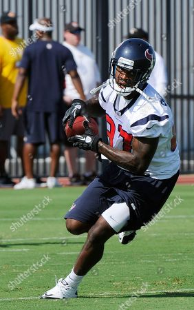 Mike Sims-Walker Houston Texans' Mike Sims-Walker is seen participating in a drill during NFL football practice, in Houston