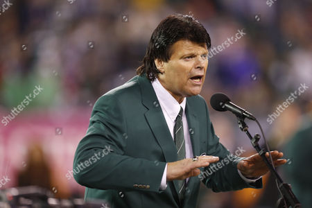 Stock Image of Mark Gastineau Former New York Jets defensive end Mark Gastineau speaks during the half time show of an NFL football game between the New York Jets and the Houston Texans, in East Rutherford, N.J