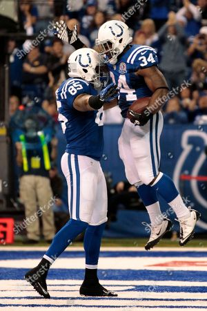 Delone Carter, Weslye Saunders Indianapolis Colts' Delone Carter (34) celebrates with Weslye Saunders after Carter ran for a 1-yard touchdown during the second half of an NFL football game against the Tennessee Titans, in Indianapolis