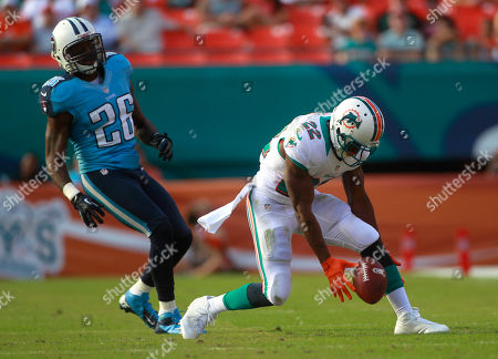 Jordan Babineaux, Reggie Bush Miami Dolphins running back Reggie Bush (22) drops a pass in front of Tennessee Titans strong safety Jordan Babineaux (26) during the second half of an NFL football game, in Miami