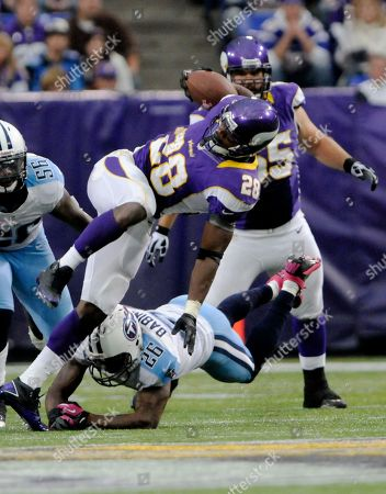 Jordan Babineaux, Adrian Peterson Tennessee Titans strong safety Jordan Babineaux (26) upends Minnesota Vikings running back Adrian Peterson (28) during the second half of an NFL football game, in Minneapolis