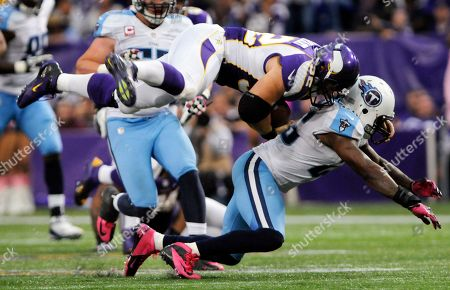 Toby Gerhart, Jordan Babineaux Minnesota Vikings running back Toby Gerhart, top, is tackled by Tennessee Titans safety Jordan Babineaux, right, during the second half of an NFL football game, in Minneapolis
