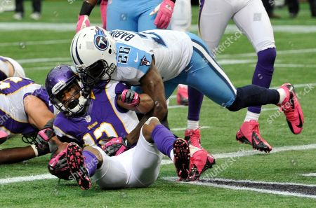 Percy Harvin, Jordan Babineaux Minnesota Vikings' Percy Harvin, left, scores on a 4-yard touchdown run ahead of Tennessee Titans' Jordan Babineaux, right, during the first half of an NFL football game, in Minneapolis