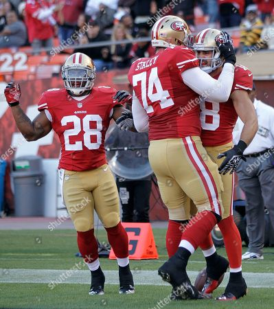 Brett Swain, Rock Cartwright, Joe Staley San Francisco 49ers wide receiver Brett Swain, right, celebrates with offensive tackle Joe Staley (74) and running back Rock Cartwright (28) after catching a touchdown pass against the Minnesota Vikings during the first quarter of an NFL preseason football game in San Francisco