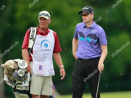 Russell Knox, Eddie Willis Russell Knox talks with caddie Eddie Willis during the second round of the Zurich Classic golf tournament at TPC Louisiana in Avondale, La