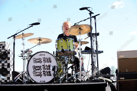 Daxx Nielsen plays drums with Cheap Trick for spectators before the NASCAR Sprint Cup Series Bad Boy Off Road 300 race held at the New Hampshire Motor Speedway in Loudon, New Hampshire. Sprint Cup Series driver Kevin Harvick (4) won the race